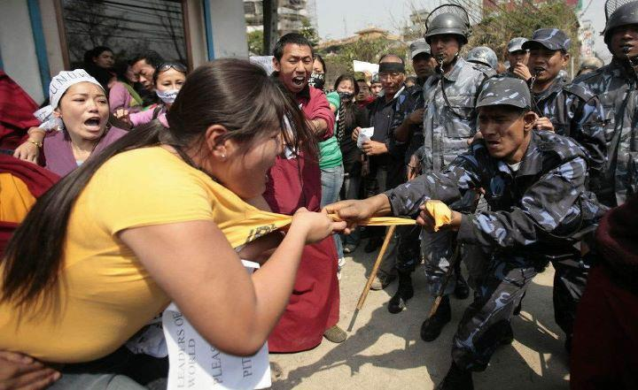 A Nepalese Police Tearing Off Tibetan Protestor S T Shirt Photo Revolution News
