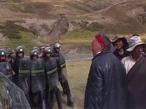 Peaceful Tibetans faced by armed Chinese military forces in Driru last year Photo: TPI