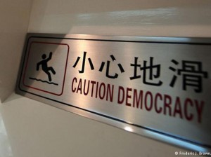 A sign used at an arts exhibition in Beijing in 2009 which reads 'Caution Democracy' Photo: AFP/Getty Images