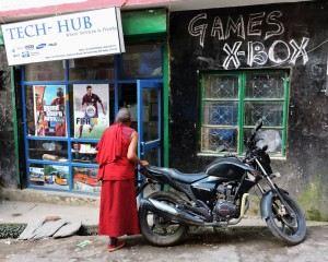 elder monk outside Xbox video game shop watching large screen (Copy)